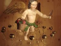 floating angel with flower basket