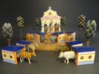 menagerie with stables and animals with chains
